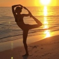 Gisele Bundchen, doing yoga, on a beach, in a bikini...